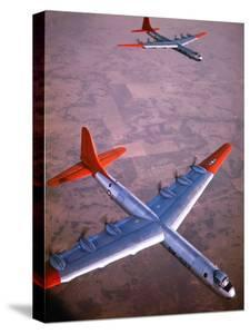 Intercontinental B-36 Bomber Flying over Texas Flatlands by Loomis Dean