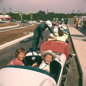 July 17 1955: Children Enjoying Disneyland's Autopia Car Ride, Anaheim, California by Loomis Dean