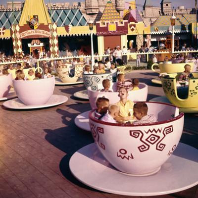 "July 17 1955: ""Mad Hatter's Tea Party"" Ride at Disneyland Amusement Park, Anaheim, California"