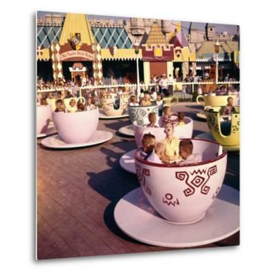 "July 17 1955: ""Mad Hatter's Tea Party"" Ride at Disneyland Amusement Park, Anaheim, California"