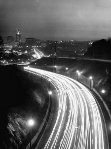 Los Angeles Traffic Traveling at Night by Loomis Dean