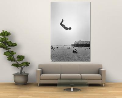 Man Flying Off a Trampoline at Santa Monica Beach
