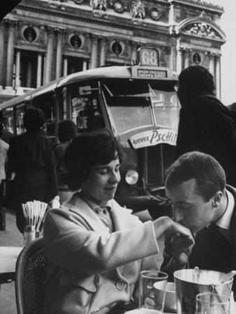 Man Kissing Woman's Hand at the Cafe de La Place de L'Opera