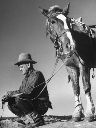 Man Sitting Holding His Horses Reins