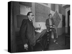 Painter Brion Gysin, Shown W His Paintings in Hotel Room in with Writer William S. Burroughs by Loomis Dean