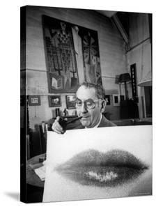 """Painter Photographer Man Ray Holding Up """"Lips"""" Print, Winking at Camera and Smoking a Pipe by Loomis Dean"""