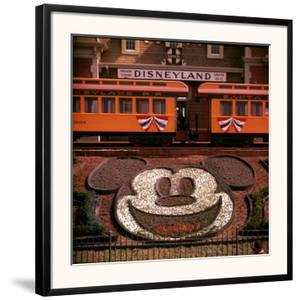 Planted Flowers Forming Design of Mickey Mouse's Face, with Disneyland Train in Background by Loomis Dean