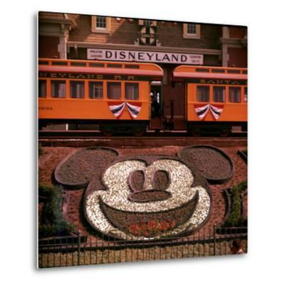 Planted Flowers Forming Design of Mickey Mouse's Face, with Disneyland Train in Background