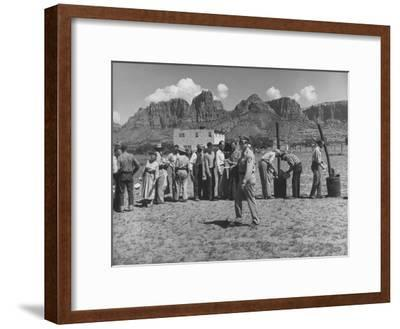 Prisoner Polygamists Lining Up after Chow Beneath the Jagged Arizona Cliffs