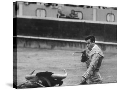 Spanish Matador, Antonio Ordonez Prepares to Kill the Charging Bull During Bullfight