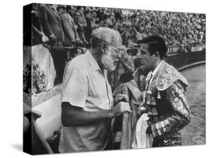 Spanish Matador Antonio Ordonez with Friend, Author Ernest Hemingway in Arena Before Bullfight by Loomis Dean