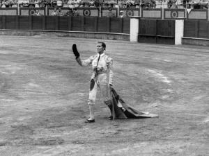 Spanish Matador Luis Miguel Dominguin Doffing His Cap as He Acknowledges the Applause of the Crown by Loomis Dean