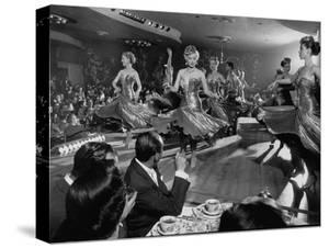 Sparkling Girls Dancing on Stage During the Las Vegas Nightlife Boom by Loomis Dean
