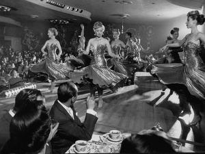 Sparkling Girls Dancing on Stage During the Las Vegas Nightlife Boom by Loomis Dean