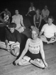 Women Meditating During their Exercises by Loomis Dean
