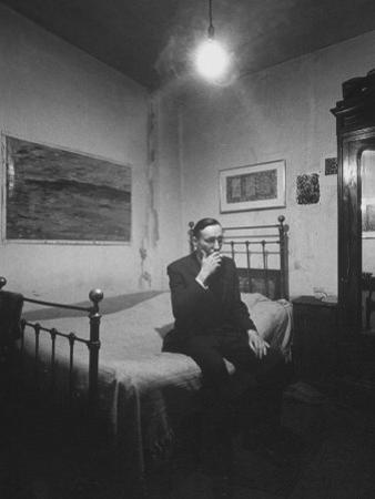 Writer William S. Burroughs Smoking on Bed in His Hotel Room