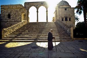 An Elderly Man Walking Behind the Dome of the Rock by Lori Epstein