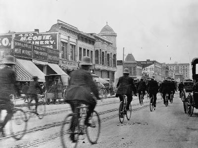 Los Angeles Police Officers Bicycling Past Broadway Storefronts--Photographic Print
