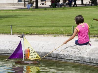 Girl with Toy Boat in Pond of Jardin Des Tuileres