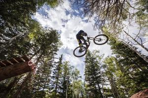 Mike Montgomery Jumping His Downhill Mountain Bike At Canyons Resort by Louis Arevalo