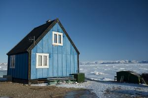 Colourful Wooden House in the Village of Qaanaaq by Louise Murray