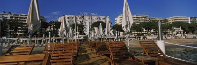 Lounge Chairs and Beach Umbrellas on the Beach, Cannes, Alpes-Maritimes, Provence-Alpes-Cote D'A...--Photographic Print