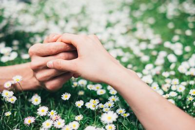 Lovers Holding Hands on Spring Flowers Field-Dirima-Photographic Print