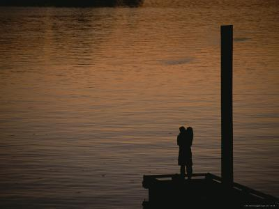 Lovers in an Embrace at Sunset on a Pier over Victoria Harbour-Todd Gipstein-Photographic Print