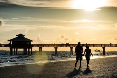 Loving Couple walking along the Beach at Sunset-Philippe Hugonnard-Photographic Print