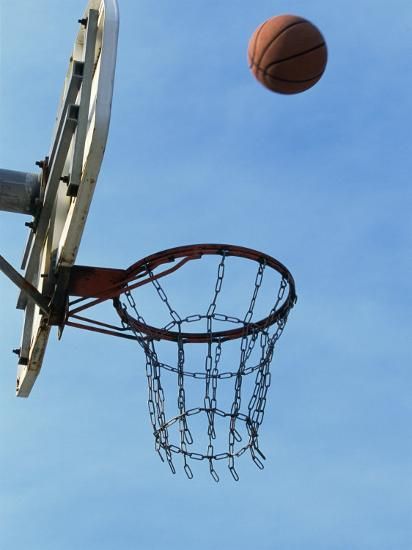 Low Angle View of a Basketball Bouncing Off The Hoop--Photographic Print