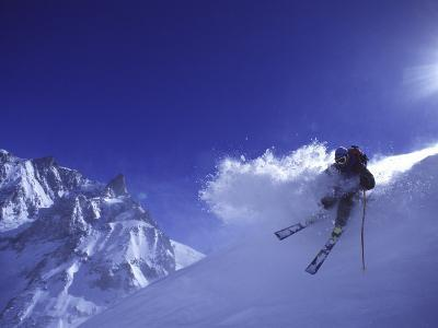Low Angle View of a Man Skiing--Photographic Print