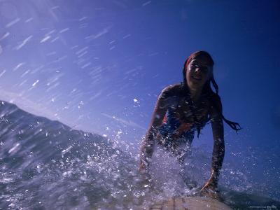 Low Angle View of a Teenage Girl Riding a Surfboard-George Silk-Photographic Print
