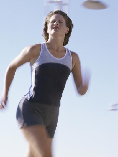 Low Angle View of a Woman Running--Photographic Print