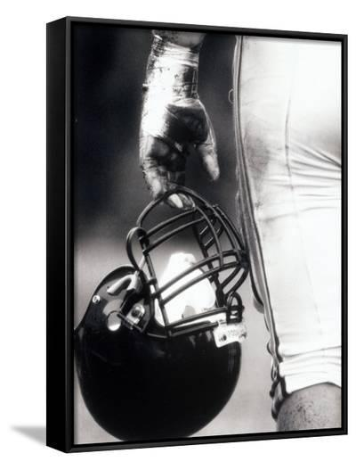 Low Angle View of An American Football Player Holding a Helmet--Framed Canvas Print