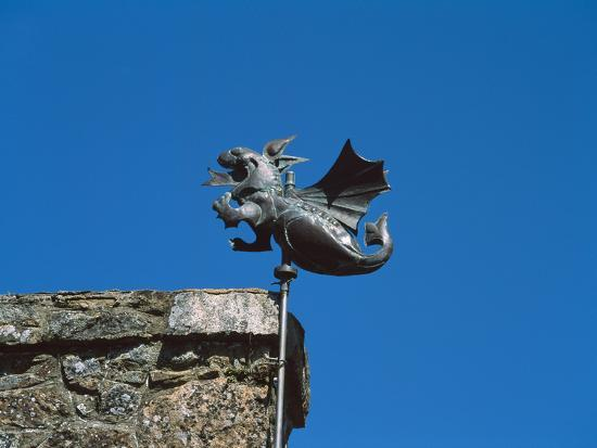 Low angle view of Girouette dragon weather vane--Photographic Print