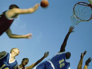 Low Angle View of Group of Young Men Playing Basketball