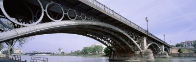 Low Angle View of Isabel II Bridge Over Guadalquivir River, Seville, Spain--Photographic Print