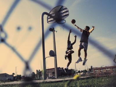 Low Angle View of Two Men Playing Basketball--Photographic Print