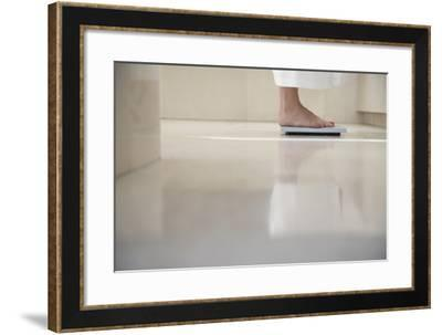 Low Section of Woman Standing on Weighing Scale in Bathroom-Nosnibor137-Framed Photographic Print