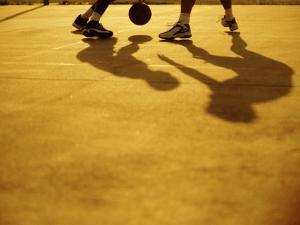 Low Section View of Two People Playing Basketball