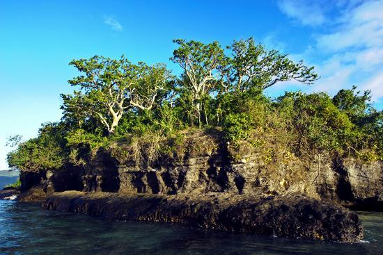 Low Tide Exposes a Limestone Coral Island Covered in Rainforest-Jason Edwards-Photographic Print
