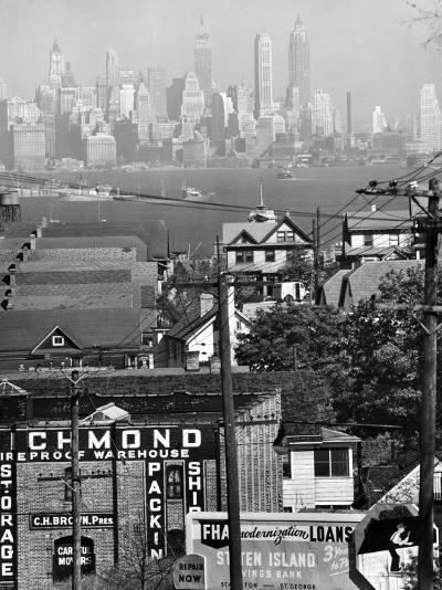 Lower Manhattan and Ferry Docks with Aid of a Telephoto Lens over the Rooftops in Staten Island-Andreas Feininger-Photographic Print