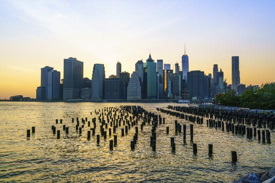 Lower Manhattan skyline across the East River at sunset, New York City, New York, United States of -Fraser Hall-Photographic Print