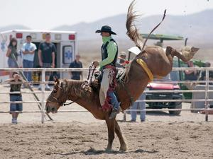 Competitor in the Bronco Riding Event During the Annual Rodeo Held in Socorro, New Mexico, Usa by Luc Novovitch