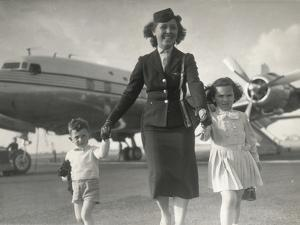 Portrait of an Air Hostess with Two Kids by Luigi Leoni