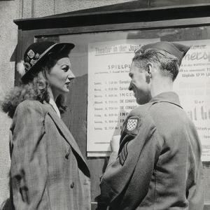 Soldier with a Young Woman in Front of the Poster of a Viennese Theater by Luigi Leoni