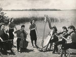 Young Musicians at a Concert on the Banks of a Lake by Luigi Leoni