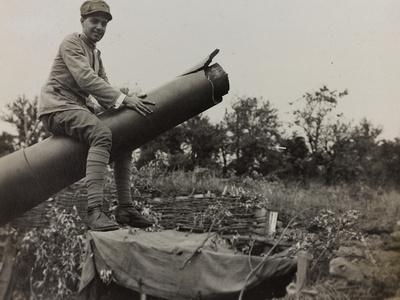 Soldier Riding a Howitzer During the First World War