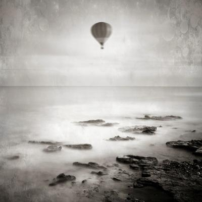 A Hot Air Balloon Floating Above the Sea by Luis Beltran