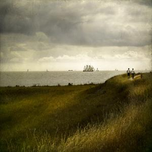 Man and Woman Walking Along a Path by the Sea with Tall Ships by Luis Beltran